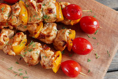 Chicken shish kebab with pepper tomato wooden skewer Royalty Free Stock Images