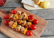 Chicken shish kebab with pepper tomato wooden skewer Royalty Free Stock Photo