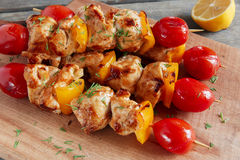 Chicken shish kebab with pepper tomato wooden skewer Stock Image