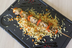 Chicken shish kebab and rice with vegetables Royalty Free Stock Photo