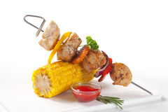 Chicken shish kebab and roasted corn Royalty Free Stock Photo