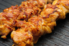 Chicken shish kebab on skewers. Preparation of chicken shish kebab on skewers stock photo