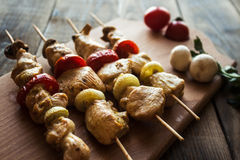 Chicken shish kebab with tomato and mushroom barbecue royalty free stock photography