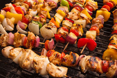 Chicken shish kebab. With vegetables on the grill Royalty Free Stock Image