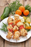 Chicken shish kebab on wooden table Stock Photo