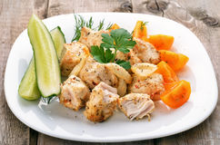 Chicken shish kebab on wooden table Royalty Free Stock Images