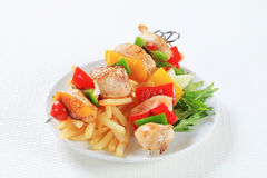 Chicken Shish kebabs with fries. Chicken Shish kebabs with French fries Royalty Free Stock Photos
