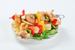 Chicken Shish kebabs with fries Stock Photos
