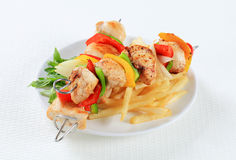 Chicken Shish kebabs with fries Stock Image