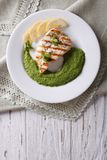 Chicken and a side dish of green peas  vertical top view Royalty Free Stock Photography