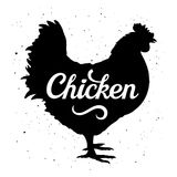 Chicken Silhouette 005. Chicken silhouette with a calligraphic inscription `Chicken` on a grunge background. Vector illustration Stock Photo