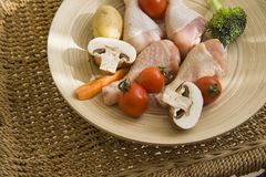 Chicken on simple plate in day light Royalty Free Stock Image