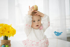 Chicken sitting on the head of a little girl with Down syndrome. Chicken sitting on the head of a little baby girl with Down syndrome Stock Photography