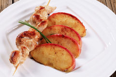 Chicken skewer and apple Royalty Free Stock Photo