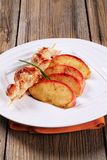 Chicken skewer and apple Stock Image