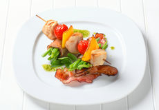 Chicken skewer and bacon-wrapped green beans. Chicken skewer and string beans wrapped in bacon Stock Photos