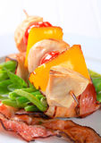 Chicken skewer and bacon-wrapped green beans. Chicken skewer and string beans wrapped in bacon Royalty Free Stock Photo