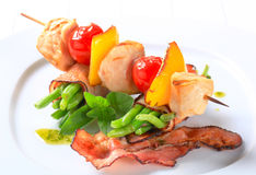 Chicken skewer and bacon-wrapped green beans Royalty Free Stock Photos