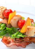 Chicken skewer and bacon-wrapped green beans Royalty Free Stock Photography