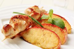 Chicken skewer and baked apple Royalty Free Stock Images