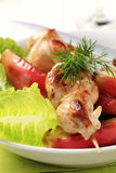Chicken skewer and baked apple Stock Photos