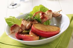 Chicken skewer with baked apple Stock Image