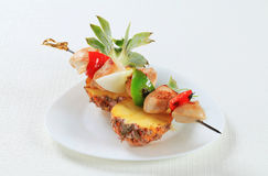 Chicken skewer and fresh pineapple Royalty Free Stock Image