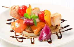 Chicken skewer with pan roasted vegetables Stock Photo