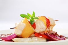 Chicken skewer with pan roasted vegetables Royalty Free Stock Images