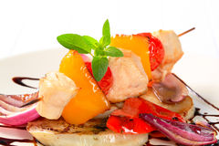 Chicken skewer with pan roasted vegetables Stock Photos