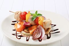 Chicken skewer with pan roasted vegetables Royalty Free Stock Image