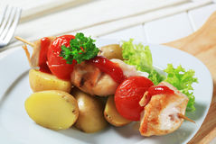 Chicken skewer with potatoes Royalty Free Stock Image