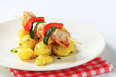 Chicken skewer with potatoes Stock Images