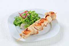 Chicken skewer with salad greens Stock Image