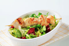 Chicken skewer and salad mix Stock Image