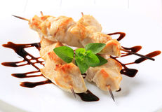 Chicken skewers. Garnished with balsamic vinegar royalty free stock photos