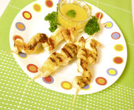 Chicken skewers. Chicken fillet skewers with sauce Stock Image