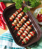 Chicken skewers after baking. Homemade baked skewers of poultry meat Stock Photography