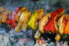 Chicken skewers with bell pepper cooked on a spit. Closeup in Evia Greece royalty free stock photos