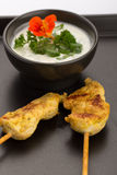 Chicken skewers and bowl Stock Image