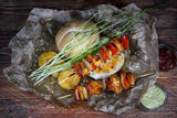 Chicken skewers with bread roll Royalty Free Stock Images