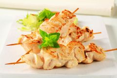 Chicken skewers. Chicken breast meat on wooden skewers royalty free stock images