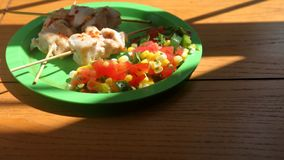 Chicken skewers and corn salsa Stock Images
