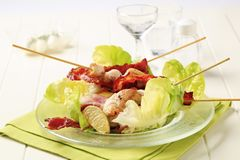 Chicken skewers and crispy bacon Stock Photos