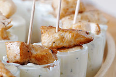 Chicken skewers with dip in glasses, party snacks on cold buffet Royalty Free Stock Images