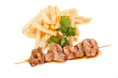 Chicken skewers with french fries Stock Images