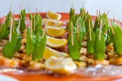 Chicken skewers with green beans and lemon stock images