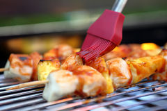 Chicken skewers with pineapple on the grill Stock Image