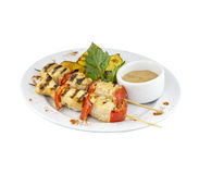 Grilled chicken skewers with potatoes and sauce. Chicken skewers with potatoes and sauce on isolated background stock photo
