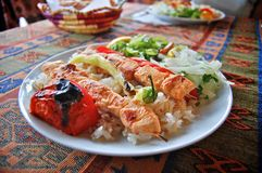 Chicken skewers with rice and vegetable salad Stock Images